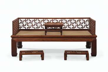 A HUANGHUALI LUOHAN BED, KANG TABLE, AND A PAIR OF HONGMU FOOT STOOLS