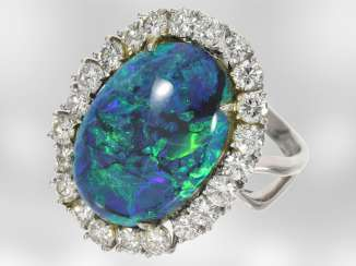 Ring: very high-quality ring with a brilliant, unusually warm, and large black opal, 18K white gold, 2.2 ct diamonds, one of a kind the court jeweller Roesner NP €12.200!