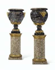 A LARGE PAIR OF FRENCH ORMOLU-MOUNTED PORTOR MARBLE VASES, ON GRANITE PEDESTALS