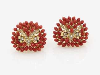 A Pair of clip earrings with coral and diamonds