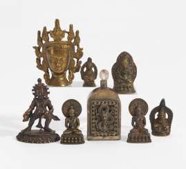 Rare standing Jambhala, five seated Buddha and a crowned Buddha head