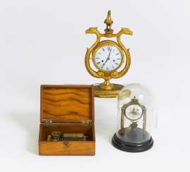 Small table clock with a Cockerel, a miniature pendulum clock with wind mill under a glass fall, a small wooden box with game factory