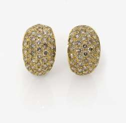 A Pair of earrings with brown diamonds