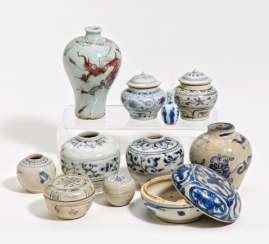Eleven small vases and lidded vessels