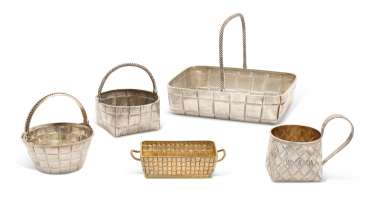 FOUR PARCEL-GILT SILVER TROMPE L'OEIL BASKETS AND A CUP