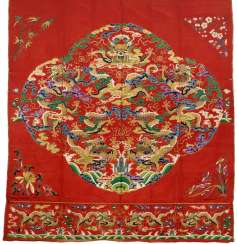 Fine embroidered curtain with motif of a dragon on red satin