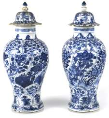 Two under glaze blue vases, made of porcelain with floral decor