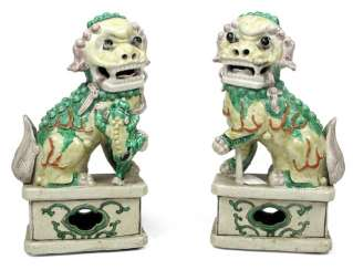 Two yellow and green glazed Fo dogs, made of porcelain