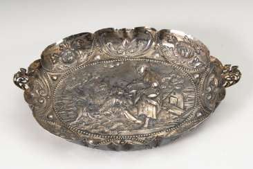 Richly carved silver bowl.