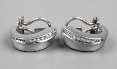 Pair of clip earrings with diamonds