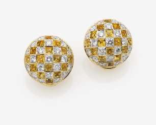 A Pair of clip-on earrings/plugs with diamonds and citrines