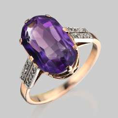 A ring of gold with natural amethyst and diamonds