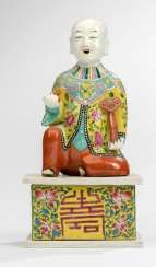 Polychrome decorated figure of a boy on a pedestal