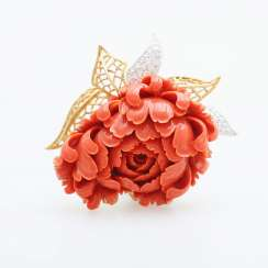 Exceptional brooch is made of a plastically-cut coral