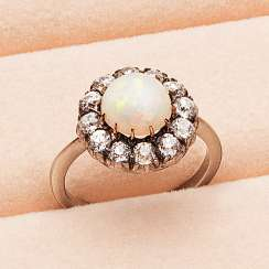 Victorian entourage ring with Opal and diamonds