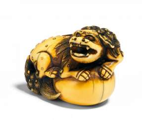 Netsuke of a Shishi-lion on a large Ball