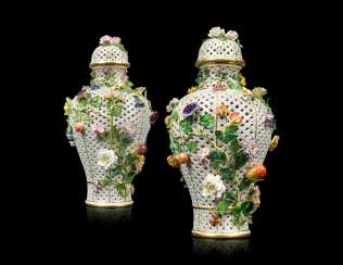 A PAIR OF LARGE MEISSEN PORCELAIN FLOWER-ENCRUSTED PIERCED VASES AND COVERS