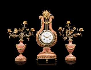 A FRENCH ORMOLU-MOUNTED AND 'JEWELED' PINK MARBLE THREE-PIECE CLOCK GARNITURE