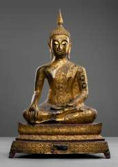 Bronze of Buddha Shakyamuni in meditation, sitting with a gold colored paint version