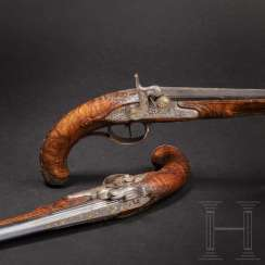 A pair of percussion pistols with a fine iron cut, South German, around 1780
