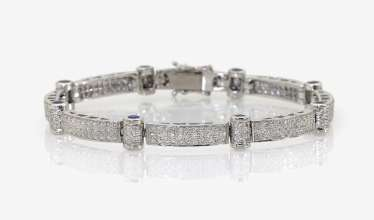 Cocktail bracelet with diamonds and sapphires