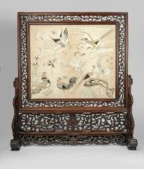 Fine silk embroidery with bird motif as a table control screen in carved Stand