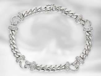 Bracelet: modern and very attractive wrought gold bracelet with brilliant trim, crafted from 18K white gold