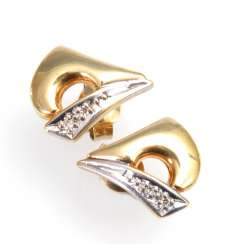 Small stud earrings, some with diamonds.