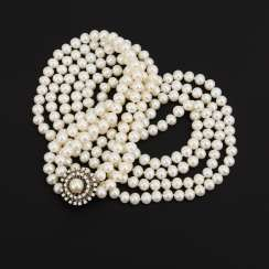 Long, 2-row cultured pearl necklace with a brilliant-cut diamond clasp
