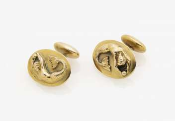 A Pair of cufflinks with astrological sign Virgo. USA, 1940s