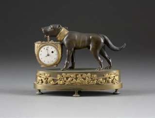 HIGHLY DECORATIVE TABLE CLOCK 'DOG WITH A BASKET'