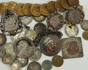 Lot of coins and coin ornaments.