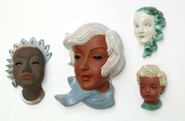 Ceramic wall masks and figures.