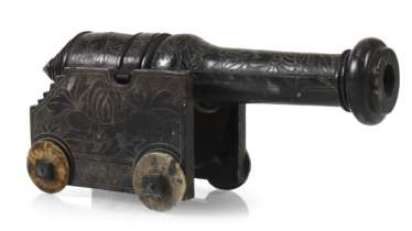 Small model of a cannon made of hand-carved soapstone