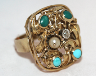 A turquoise ring with diamond and pearls