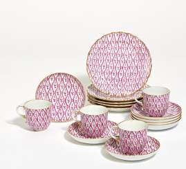 12 place settings of a coffee service with purple decor