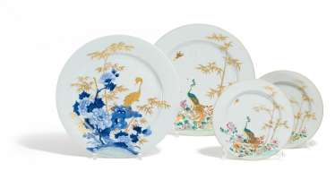 Single large and Pair of smaller plates with peacocks