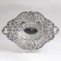 Openwork silver bowl with dragon motif
