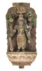 Wood carving with a depiction of the Ganesha