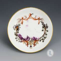 Saucer with equestrian motif