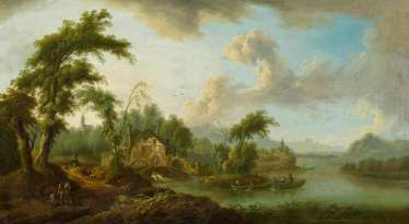 Idyllic river landscape with a water mill