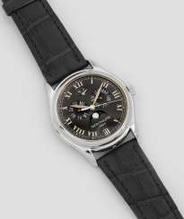 Mens wrist watch by Patek Philippe with perpetual calendar