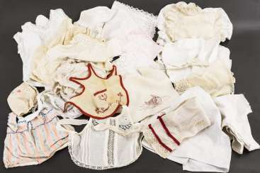 Mixed lot of baby doll clothes and pillow cases