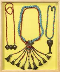 Group of chains, partly made of glass and coral, partly with bronze pendants