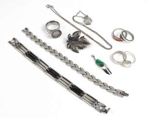 Item of silver and steel jewelry among others