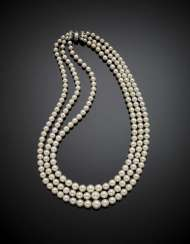 Three strand graduated cultured pearl necklace with white gold diamond clasp in all ct. 1.60 circa
