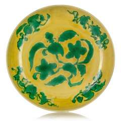 Large, yellow glazed porcelain bowl with green décor of gardenias and branches