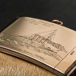 Golden, very finely engraved match case as a reminder to the construction of the Russian armored cruiser