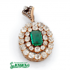 Transformer pendant with emerald