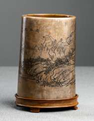 Ivory brush Cup with a depiction of the landscape